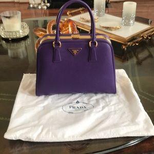 Purple Prada top handle bag